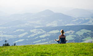 The Moment of Peace - Young woman meditating outdoors